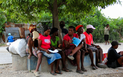 Women reading and learning on the street, Port-Au-Prince, Haiti, 2012.