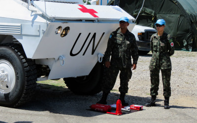 Military woman in a training with tank and armaments in UN Mission, Port-Au-Prince, Haiti, 2012.