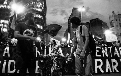 Attention call: protesters carrying a turnstile that will be burnt, Belo Horizonte, Brazil, 2014.