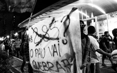 Students showing posters in public,  reclaiming for  free tariff in public transports, Belo Horizonte, Brazil, 2014.