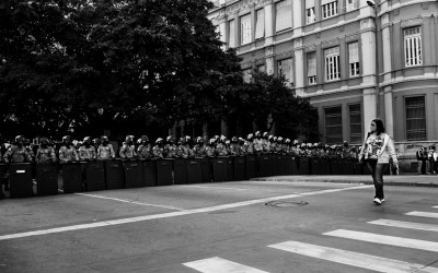 Police  barrier to contain protesters. frightened residents in central region, Belo Horizonte, Brazil, 2014.