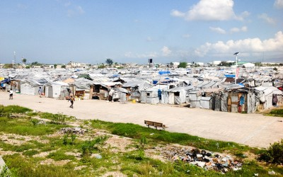 Displaced Camp Parc Jean Marie Vincent.  Residents of camps like this live with fear and terror, especially women, who are often victims of rape or threats. Port-au-Prince, Haiti, 2012.