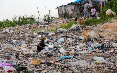 To survive, residents look for contaminated food or objects that can be sold to ensure survival. In activities like this the contamination by the garbage is inevitably. Port-au-Prince, Haiti, 2012.