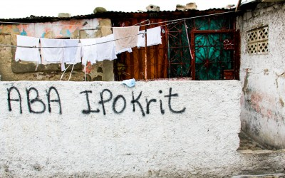 "With a history of political corruption and extreme social inequality, the Haitian population questions and asks for more justice. ""Aba Ipokrit"", in the Haitian dialect Creole means ""Down to Hypocrisy"". Port-au-Prince, Haiti, 2012."