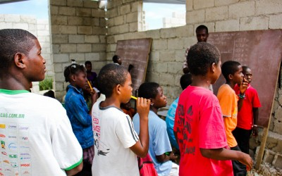Small schools in port-au-prince are maintained by resident teachers, NGOs, churches and by initiatives of the UN or military willing to contribute on a voluntary basis, even without full conditions. Port-Au-Prince, Haiti, 2012.