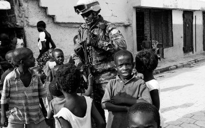 1.Peacekeepers with children in Cité Soleil, Port-Au-Prince, Haiti, 2012.
