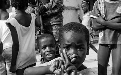 Peacekeeper with children in Cité Soleil, Port-Au-Prince, Haiti, 2012.