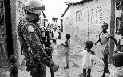 "Peacekeeper in mission in Cité Soleil, one of the most dangerous region, before the project ""Clean Quarter"", Port-Au-Prince, Haiti, 2012."
