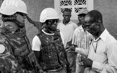 Dialogue between resident of Cité Soleil and peacekeeper mediated by local translator, Port-Au-Prince, Haiti, 2012.
