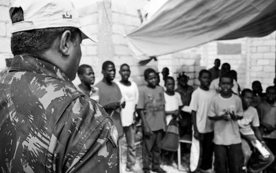Peacekeeper while monitoring the activities school promoted by MINUSTAH Mission, Port-Au-Prince, Haiti, 2012.