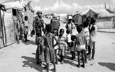 Sometimes journalists and UN Officers talk with the community seeking improvements. Parc Jean Marie Vincen, Port-Au-Prince, Haiti, 2012.