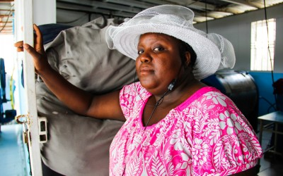 Washerwoman  in former military Brabatt I by UN Mission, Port-Au-Prince, Haiti, 2012.