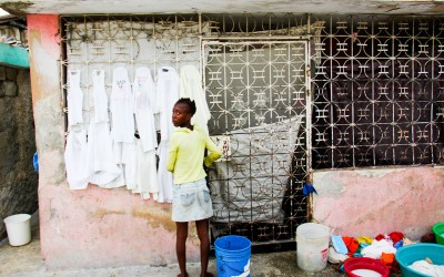 Washerwoman and homemaker in Cite Soleil, Port-Au-Prince, Haiti, 2012.
