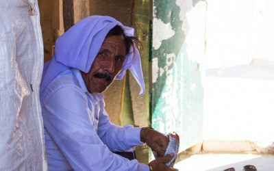Muslim man in Cover II Refugee Camp, Iraq (Iraqi Kurdistan). In the region, and now in the camps, civilians are tolerant of one another in relation to religion. Muslim families, Yazidis and Catholics live with respect and compassion.