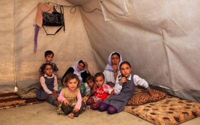 In some cases, residents welcome children from the family and from friendly families who lost their parents and caretakers initially legit. There are 9 people in this tent, 7 of them children. Cover II Refugee Camp, near Duhok, Iraq (Iraqi Kurdistan).