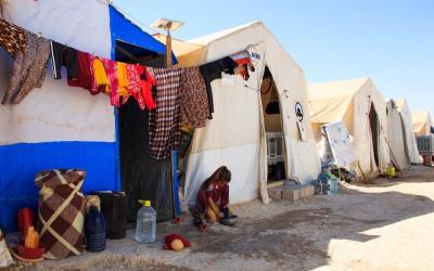 Yazidi girl does housework while she should be studying or playing. Sharia Refugee Camp, near Duhok, Iraq (Iraqi Kurdistan).