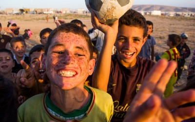 Children playing soccer in the Sharia Refugee Camp. Already in their adolescence, many children can already understand what is happening with their families. Consequently, many of their dreams become harder to come true. Nevertheless, with a contagious happiness they keep showing that one needs to believe that a positive change will come, and that they might even become professional soccer players, Duhok, Iraqi Kurdistan, 2015.