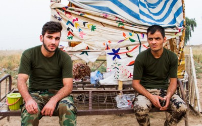 Young peshmergas waiting to enter the next shift. Even though Kurdistan often does not have the conditions to pay soldiers, they work and are dedicated to protecting communities against the Islamic State (ISIS). Iraq (Iraqi Kurdistan), Middle East, 2015.