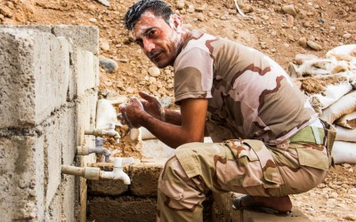 Peshmerga in his moment of personal hygiene. Even though almost always precarious conditions, the combatants fight with all the energy and dedication so that the legacy of the Islamic State (ISIS) finishes. Iraq (Iraqi Kurdistan), Middle East, 2015.