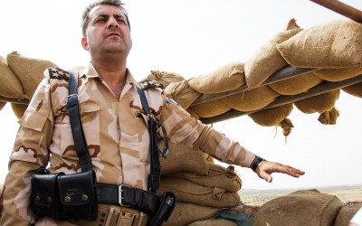 Commander of one of the Peshmergas bases tells how the fighting works since the frontline is a few meters from the Islamic State (ISIS). According to him, weekly car bombs approach the peshmergas and attack them. Iraq (Iraqi Kurdistan), Middle East, 2015.